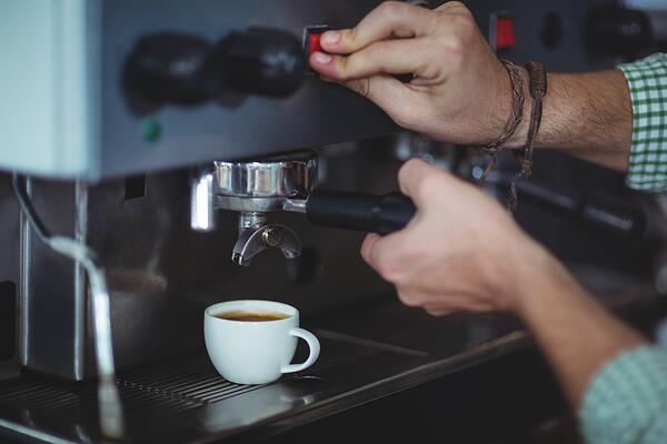 Waiter making cup of coffee in cafe-1